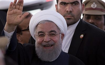 Iranian President Hassan Rouhani gestures towards media after offering Friday prayers at the Mecca Mosque in Hyderabad, India, February 16, 2018. (AP Photo /Mahesh Kumar A.)