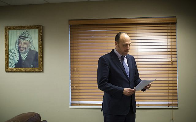 Husam Zomlot, the Palestinian envoy to Washington, reviews papers in Washington, Friday, February 16, 2018. (AP Photo/Pablo Martinez Monsivais)