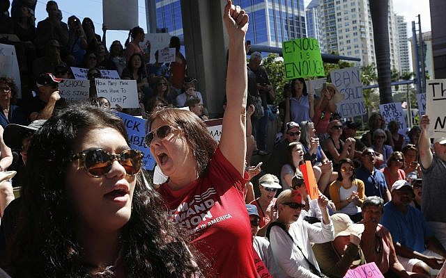 Protesters call for stricter gun laws in wake of Florida school shooting