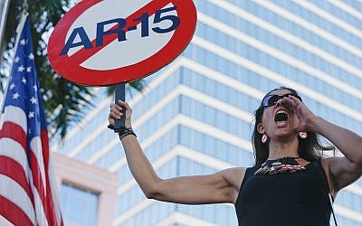 Demonstrators at protest against guns on the steps of the Broward County Federal courthouse in Fort Lauderdale, Florida, on Saturday, February 17, 2018. (AP Photo/Brynn Anderson)