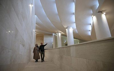 In this February 7, 2018, photo, Reza Daneshmir, right, gestures as he talks with his wife Catherine Spiridonoff, both architects of Vali-e-Asr mosque, while they walk on one of the mosque's ramps, in Tehran, Iran. (AP Photo/Vahid Salemi)