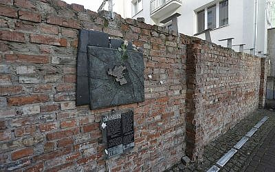 A fragment of the former Warsaw Ghetto wall in Sienna 53 street that regional official for preservation of historical sites wants put on a list of protected historical monuments, in Warsaw, Poland, Tuesday, Feb. 20, 2018 (AP Photo/Czarek Sokolowski)