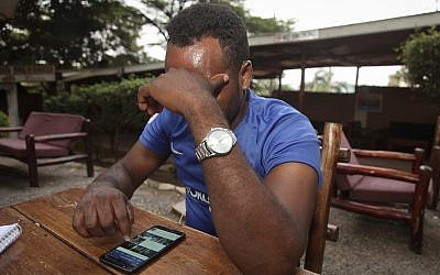 In this Sunday, February 11, 2018, photo, Eritrean migrant Yohannes Tesfagabr, one of the tens of thousands of African migrants Israel has targeted for deportation, recounts his journey to The Associated Press in Kampala, Uganda. (AP Photo/Stephen Wandera)