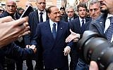 Former Italian Premier Silvio Berlusconi is cheered by followers prior to a meeting with European People's Party President Manfred Weber, in Rome, February 21, 2018. (Ettore Ferrari/ANSA via AP)