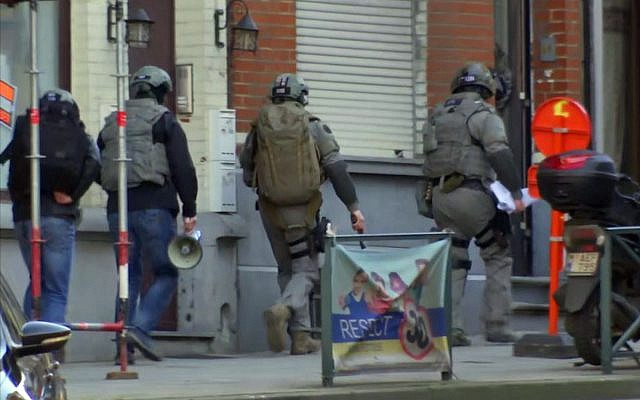 Belgium security personnel enter a building in Brussels in this image taken from TV Thursday Feb. 22, 2018. (AP Photo)
