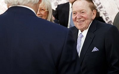 In this May 23, 2017, photo, Sheldon Adelson, right, talks with Secretary of State, Rex Tillerson, before a speech by US President Donald Trump at the Israel Museum in Jerusalem. (AP Photo/Evan Vucci)