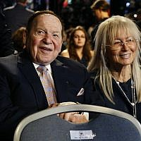 In this September 26, 2016, photo, Chief Executive of Las Vegas Sands Corporation Sheldon Adelson sits with his wife Miriam waits for the presidential debate between Democratic presidential nominee Hillary Clinton and then-Republican presidential nominee Donald Trump at Hofstra University in Hempstead, NY. (AP Photo/Patrick Semansky)