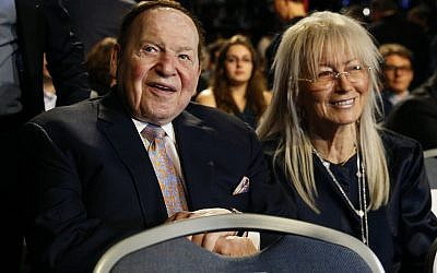 In this September 26, 2016, photo, Chief Executive of Las Vegas Sands Corporation Sheldon Adelson sits with his wife Miriam at a presidential debate between Democratic presidential nominee Hillary Clinton and then-Republican presidential nominee Donald Trump at Hofstra University in Hempstead, NY. (AP Photo/Patrick Semansky)