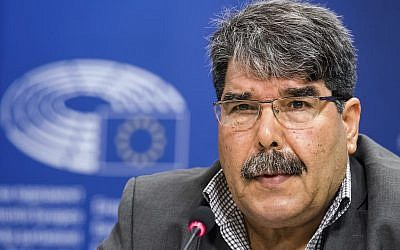 In this Sept. 1, 2016, file photo, then co-chair of the Syrian Kurdish Democratic Union Party (PYD) Salih Muslim addresses journalists at the European Parliament in Brussels. (AP Photo/Geert Vanden Wijngaert, File)