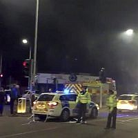 In this image taken from video made available by Gem News, police attend the scene of an incident in Leicester, central England, Sunday, February 25, 2018. (Gem News via AP)