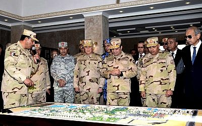 Egyptian President Abdel-Fattah el-Sissi, center, attends the inauguration of the East Suez Canal Counter-Terrorism command, in Sinai, Egypt on February 25, 2018.  (MENA via AP)
