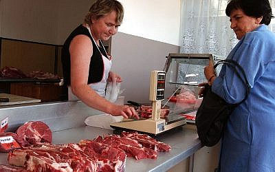 A consumer buys meat in Warsaw, Poland, Friday July 9, 2004. After Poland joined the European Union on May 1st, food prices increased in the country, with the sharpest rise,  21.7 percent, for meat.(AP/Alik Keplicz)