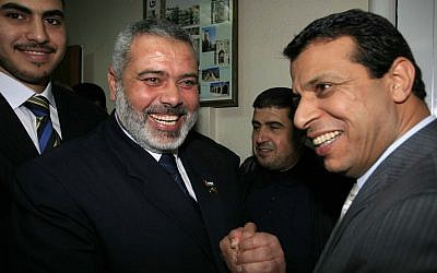 Ismail Haniyeh, left, smiles as he celebrates with Fatah strongman Mohammed Dahlan in Gaza City on Saturday, March 17, 2007. (AP Photo,File)