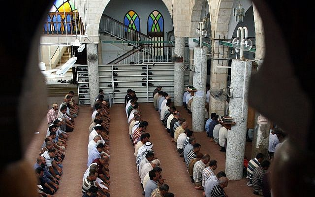 Palestinian worshipers are seen praying in a mosque in Jenin. (AP Photo/Mohammed Ballas/File)