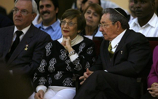 Cuba's President Raul Castro, right, sits next to Adela Dworin, president of Cuba's Jewish community, during a Hanukkah ceremony at the Beit Shalom synagogue in Havana, Sunday Dec. 5, 2010. (AP Photo/Ismael Francisco, Prensa Latina)