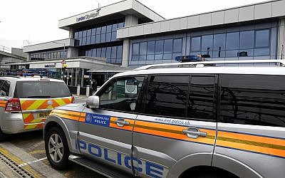 Police cars parked outside London City Airport, September 6, 2016. (AP Photo/Kirsty Wigglesworth)