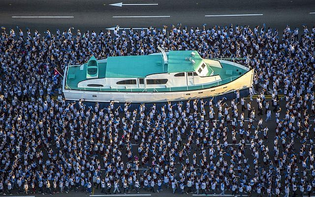A replica of the Granma yacht is surrounded by students during a military parade in honor of late Cuban leader Fidel Castro in Revolution Square in Havana, Cuba, Monday, Jan. 2, 2017. (AP Photo/Desmond Boylan, Pool)