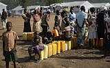 Illustrative: South Sudanese refugees line up to fill their plastic containers with water from a tap at the Imvepi reception center, where newly arrived refugees are processed before being allocated plots of land in nearby Bidi Bidi refugee settlement, in northern Uganda,, June 9, 2017. (AP Photo/Ben Curtis)