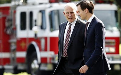 White House Chief of Staff John Kelly, left, talks with White House senior adviser Jared Kushner as they walk to Marine One on the South Lawn of the White House, Thursday, August 3, 2017, in Washington, DC. (AP Photo/Alex Brandon)