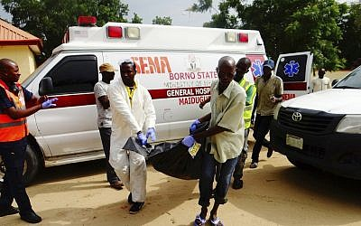 Illustrative: Rescue workers offload a body from an ambulance following a suicide attack at a Market in Konduga outside Maiduguri, Nigeria Wednesday, Aug. 16, 2017. (AP Photo/ Jossy Ola)