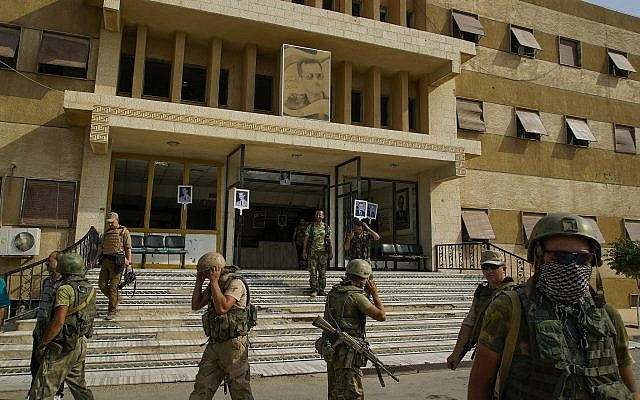 In this Friday, Sept. 15, 2017 photo Russian military police soldiers walk out side a hospital in Deir el-Zour, Syria. (AP Photo)