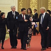 US President Donald Trump and Chinese President Xi Jinping, center, talk to each other as they arrive for a state dinner at the Great Hall of the People, Thursday, November 9, 2017, in Beijing. (AP/Andrew Harnik)