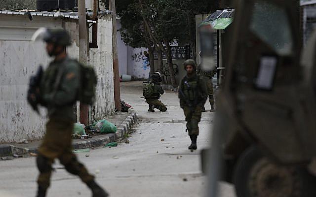 Israeli troops patrol the streets of the West Bank city of Jenin, Thursday, Jan. 18, 2018 (AP Photo/Majdi Mohammed)
