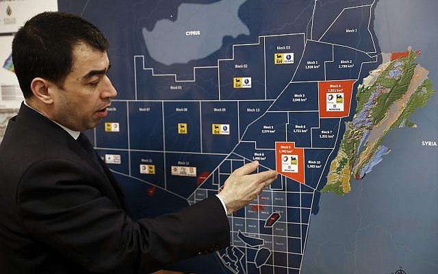 Lebanon's Energy Minister Cesar Abi Khalil, explains on the map about the offshore block 9 which Israel claims, during an interview with the Associated Press at his office, in Beirut, Lebanon,  February 1, 2018. (Hussein Malla/AP)