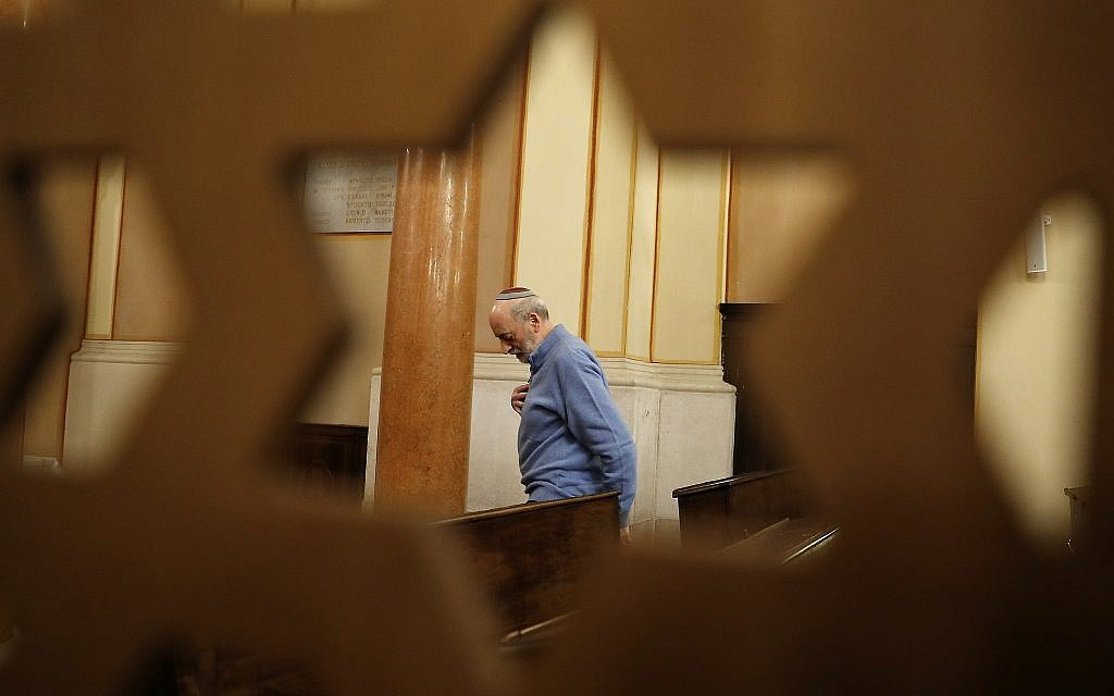 In this photo taken on Friday, Feb. 2, 2018, President of the Jewish Community Bruno Carmi stands inside a synagogue in Verona, Italy, February 2, 2018. (AP Photo/Antonio Calanni)