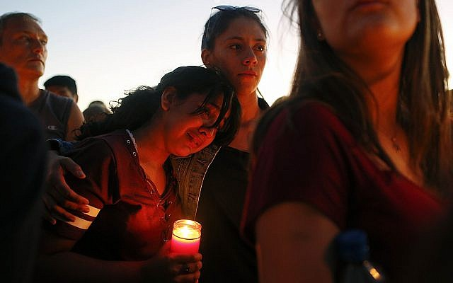 Students gather during a vigil at Pine Trails Park for the victims of the Wednesday shooting at Marjory Stoneman Douglas High School, in Parkland, Fla., Thursday, February 15, 2018. (AP Photo/Brynn Anderson)