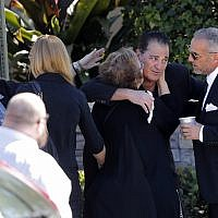 Family and friends console each other as they arrive for the funeral of Meadow Pollack, a victim of the Wednesday shooting at Marjory Stoneman Douglas High School, in Parkland, Fla., Friday, Feb. 16, 2018.  (AP Photo/Gerald Herbert)