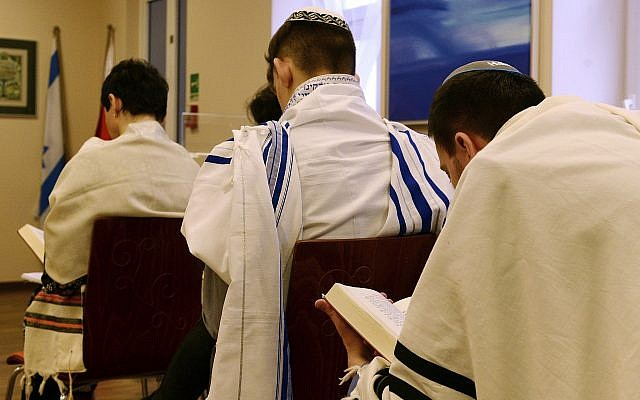 Illustrative photo of Jewish people praying in a synagogue in Warsaw, Poland, on February 10, 2018. (AP Photo/Alik Keplicz)