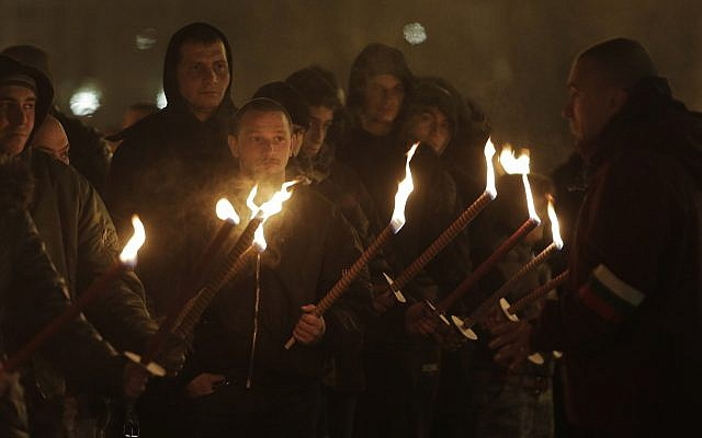 Far-right activists march with torches during a march to commemorate pro-Nazi Bulgarian general Hristo Lukov in Sofia on February 17, 2018. (AP Photo/Valentina Petrova)