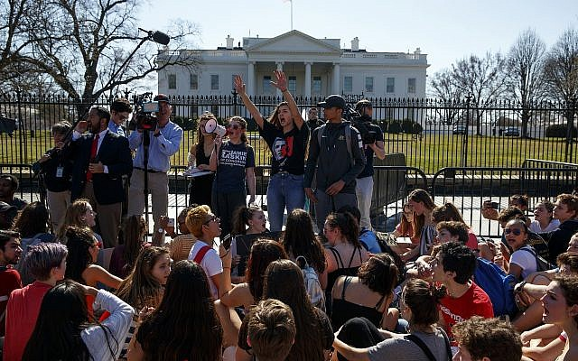 Illustrative image of demonstrators taking part in a student protest for gun control legislation in front of the White House,, February 21, 2018, in Washington. (AP Photo/Evan Vucci)