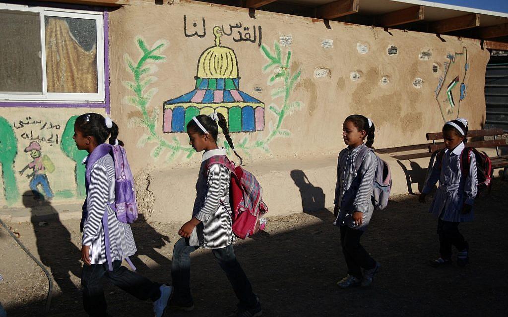 Bedouin students arrive at school at Khan al-Ahmar, near the Kfar Adumim settlement in the West Bank on September 2, 2016. (AP/Majdi Mohammed)