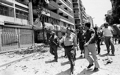Palestine Liberation Organization leader Yasser Arafat inspects the damage in the Arab University area of West Beirut August 2, 1982, following a heavy bombardment by the Israeli air force the day before.  (Mourad Raouf/AP)