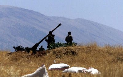 Illustrative photo of Syrian soldiers preparing an anti-aircraft gun, 2001. (photo credit: AP/File)