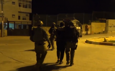 Police arrest a suspect during a raid in the West Bank town of al-Ram on February 5, 2018. (Screen capture: Twitter)