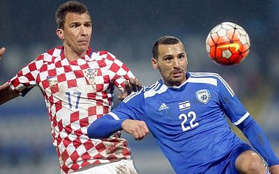 Israel's Shir Meir Tzedek, right, is challenged by Croatia's Mario Mandzukic during the international friendly soccer match between Croatia and Israel in Osijek, Croatia, Wednesday, March 23, 2016. (Darko Bandic/AP)