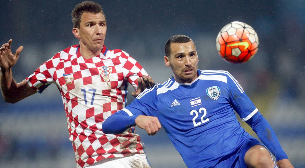 43d2926b090 Israel's Shir Meir Tzedek, right, is challenged by Croatia's Mario  Mandzukic during the international