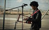 An Eritrean musician performs outside the Holot detention facility, January 29, 2018. (Luke Tress/Times of Israel)