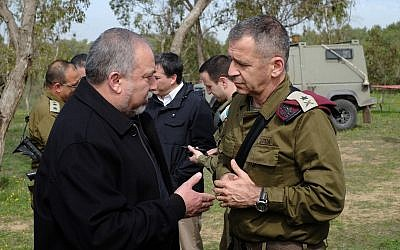 Defense Minister Avigdor Liberman, left, speaks to IDF Deputy Chief of Staff Maj. Gen. Aviv Kochavi in a field just outside the  Gaza Strip on February 20, 2018. (Judah Ari Gross/Times of Israel)