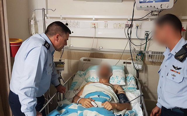 Air Force head Amiram Norkin, left, and an unidentified officer, right, visiting an injured pilot in Rambam Hospital in Haifa on February 11, 2018, in a picture released by the IDF on February 12, 2018. (IDF Spokesperson's Unit)