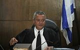 Judge Khaled Kabub seen at the Tel Aviv District Court  during the opening session in the State prosecution against former Chairman of IDB Group Nochi Dankner, July 13, 2014. (Lior Ben Nisan/POOL/Flash90)
