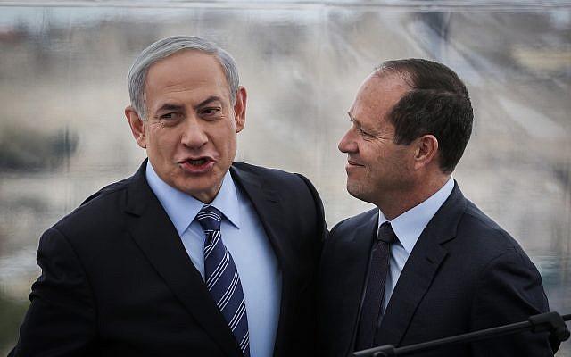 Prime Minister Benjamin Netanyahu (left) and Jerusalem Mayor Nir Barkat (right) hold a press conference at the Mamilla Hotel in Jerusalem, February 23, 2015. (Hadas Parush/Flash90)