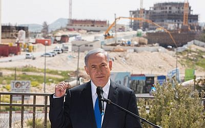 Illustrative: Prime Minister Benjamin Netanyahu gives a statement to the press during a visit in Har Homa, in East Jerusalem on March 16, 2015. (Yonatan Sindel/Flash90)