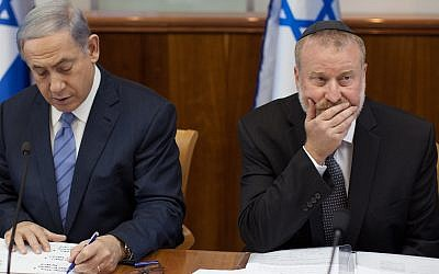Prime Minister Benjamin Netanyahu (left) and Attorney General Avichai Mandelblit at a July 2015 cabinet meeting, when Mandelblit was serving as cabinet secretary. (Emil Salman/POOL)