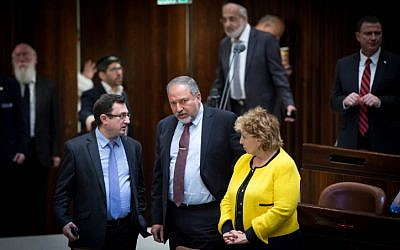 Yisrael Beytenu party leader Avigdor Liberman (C) seen during a plenum session in the Israeli parliament on December 30, 2015. On the left is Yisrael Beytenu MK Robert Ilatov; to his right is Immigration Absorption Minister Sofa Landver. (Miriam Alster/FLASH90)