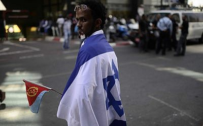 Eritrean migrants protest in front of the European Union embassy in Ramat Gan, near Tel Aviv, calling for the EU to try the Eritrean leadership for crimes against humanity, on June 21, 2016. (Tomer Neuberg/Flash90)