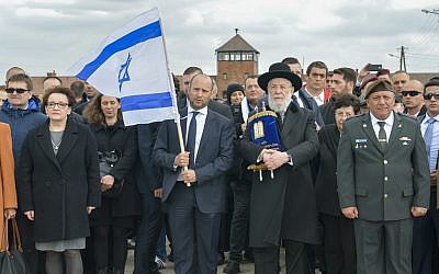 Education Minister Naftali Bennett (2nd-L), Rabbi Meir Lau (2nd-R) and IDF Chief of Staff Gadi Eisenkot (R) take part in the March of the Living at the Auschwitz-Birkenau camp site in Poland on April 24, 2017. (Yossi Zeliger/Flash90)
